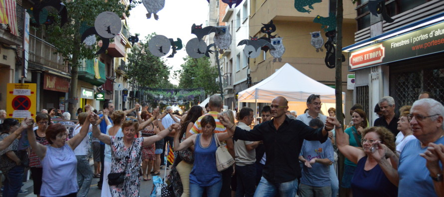 Raül Romeva, cap de llista de Junts pel Sí, gaudeix de la Festa Major de Sants